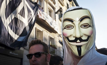 guy fawkes masked Protestor. The Action Pixel. @TheActionPixel